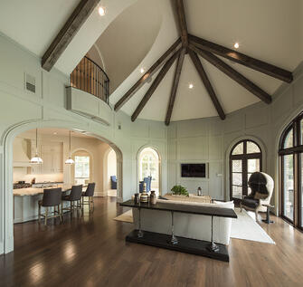 luxury home with high ceilings and beams