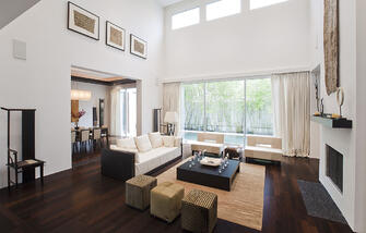 custom contemporary living room with high ceilings