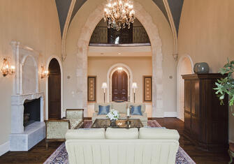 spanish mission living room with high ceilings