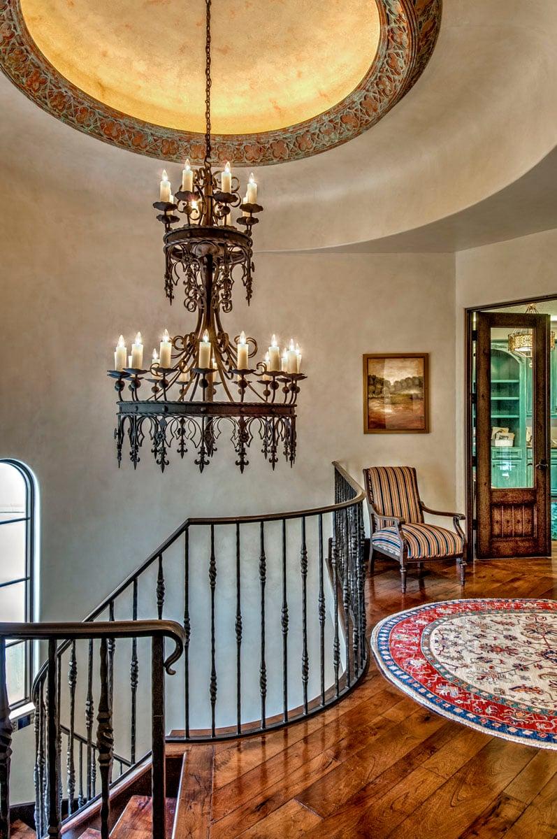 spanish mediterranean chandelier at staircase