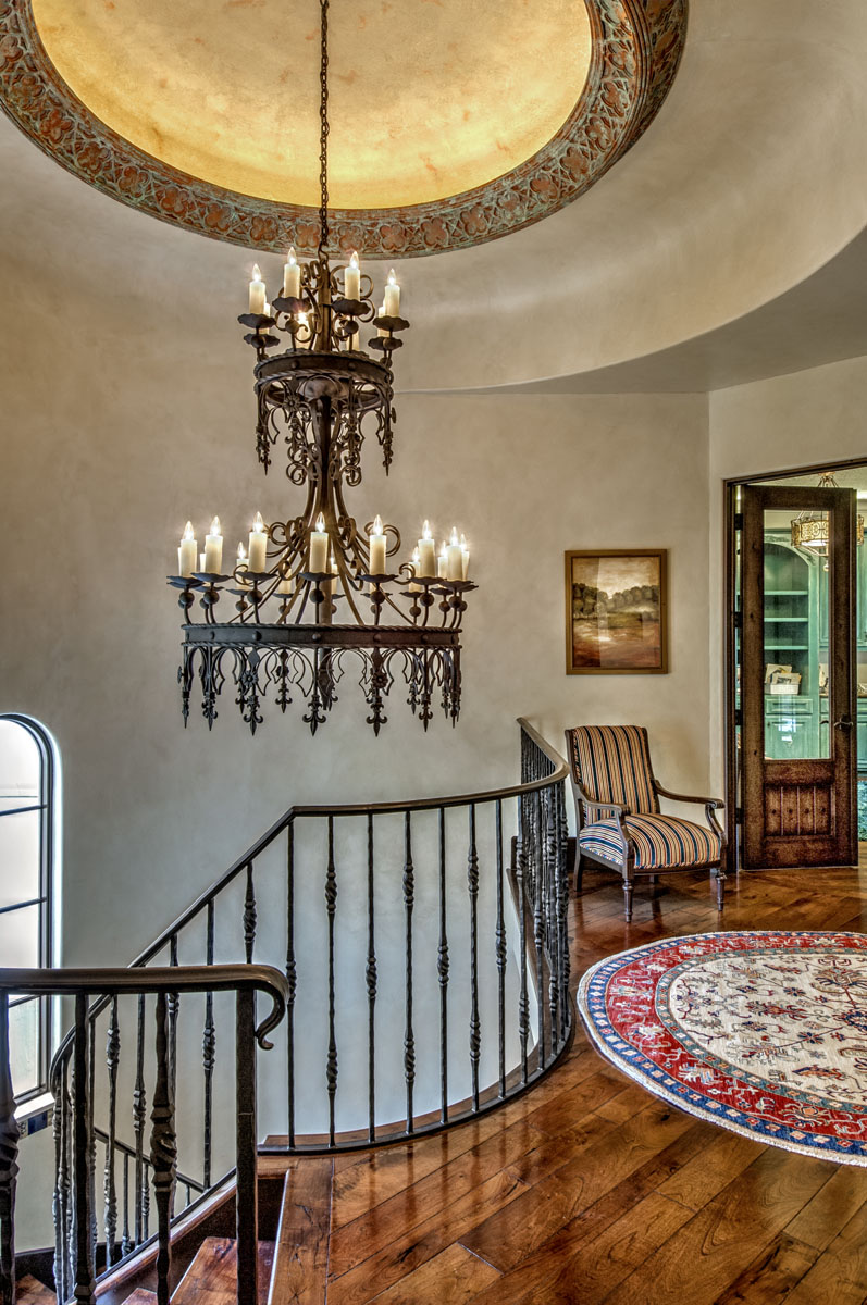 spanish mediterranean chandelier at staircase
