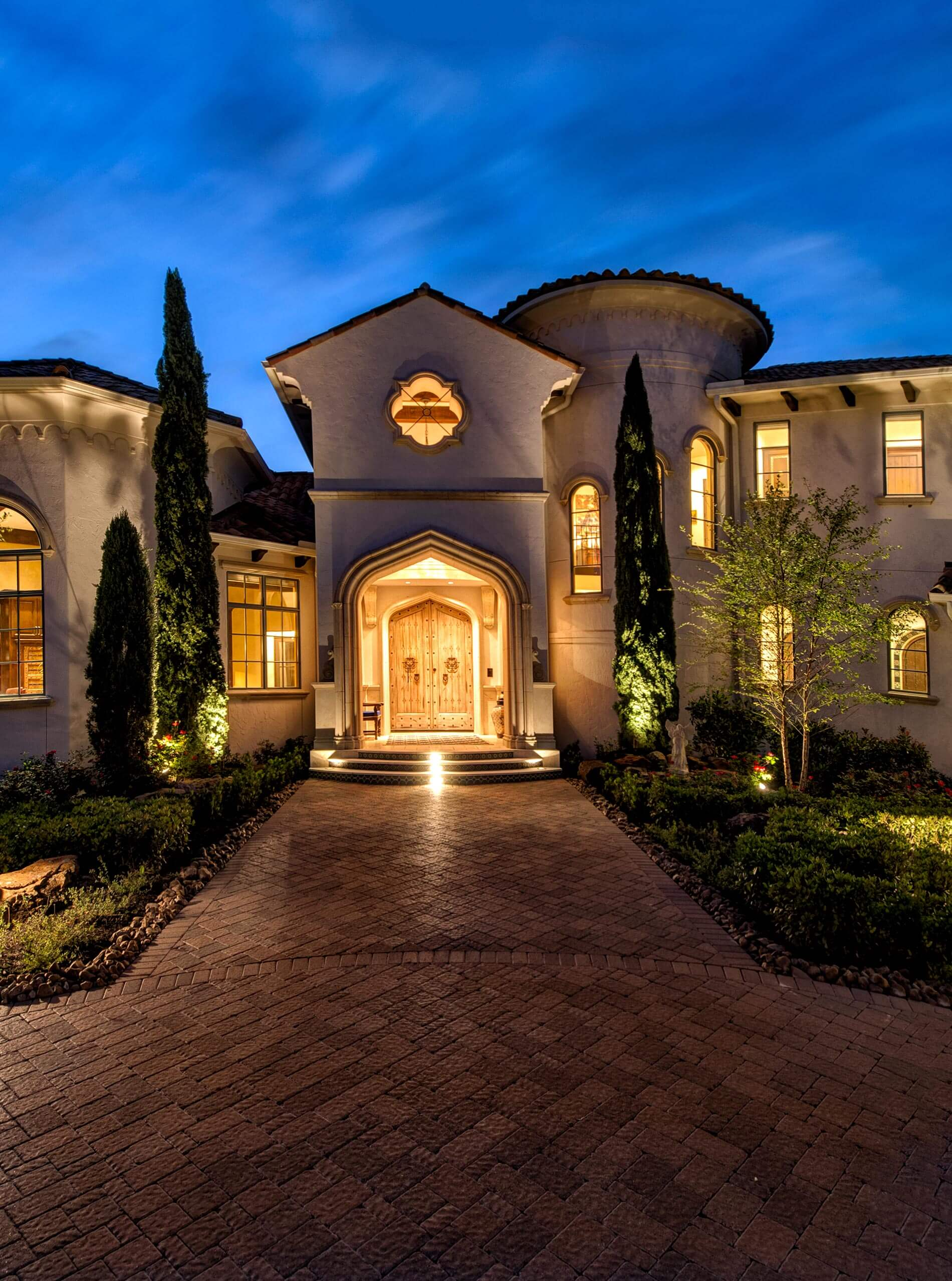 front walkway at night on custom home