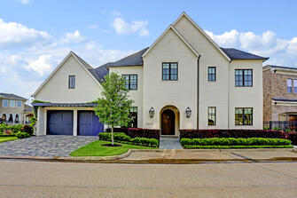 Transitional luxury home front