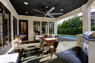 Transitional luxury home outdoor dining room