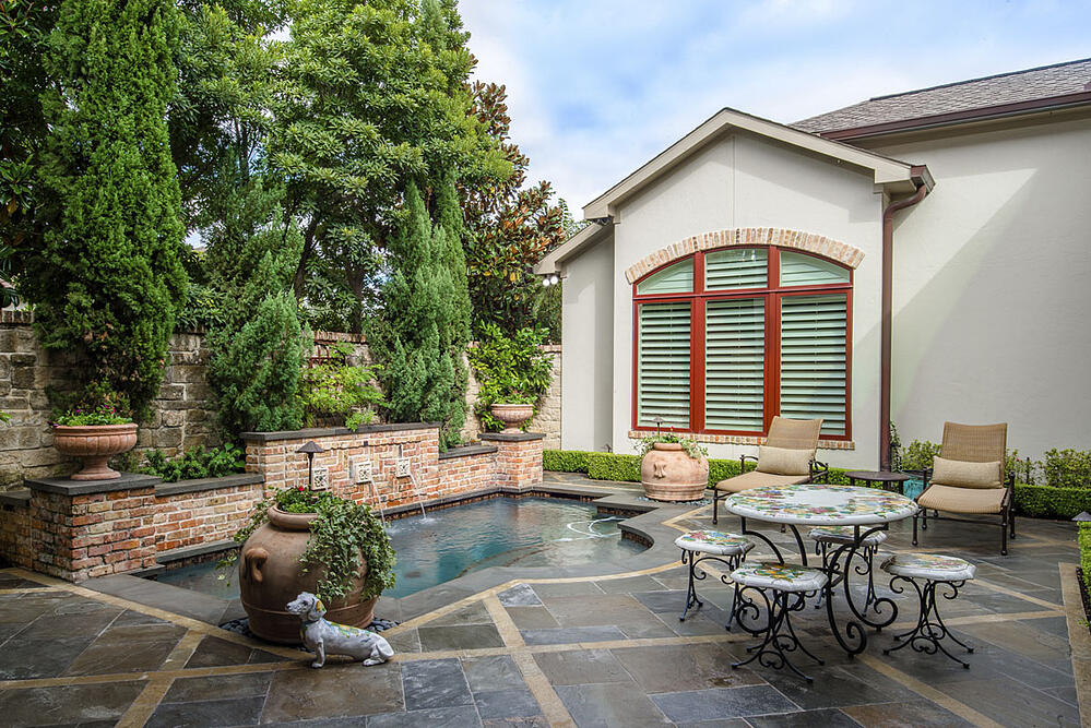 backyard patio and pool of custom home