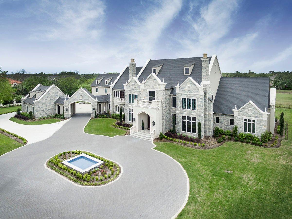 english tudor front driveway aerial view