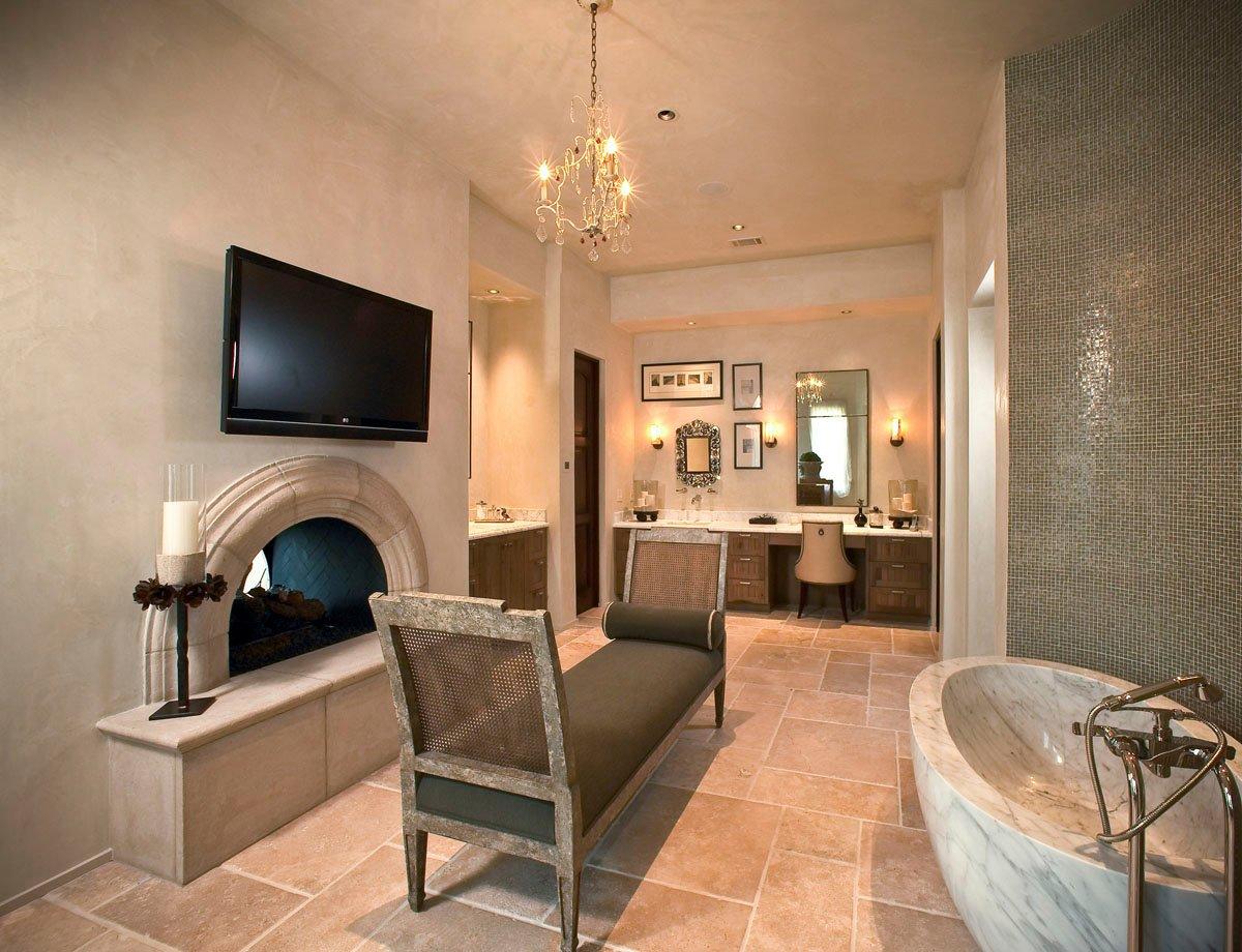 custom tuscan villa bathroom tv