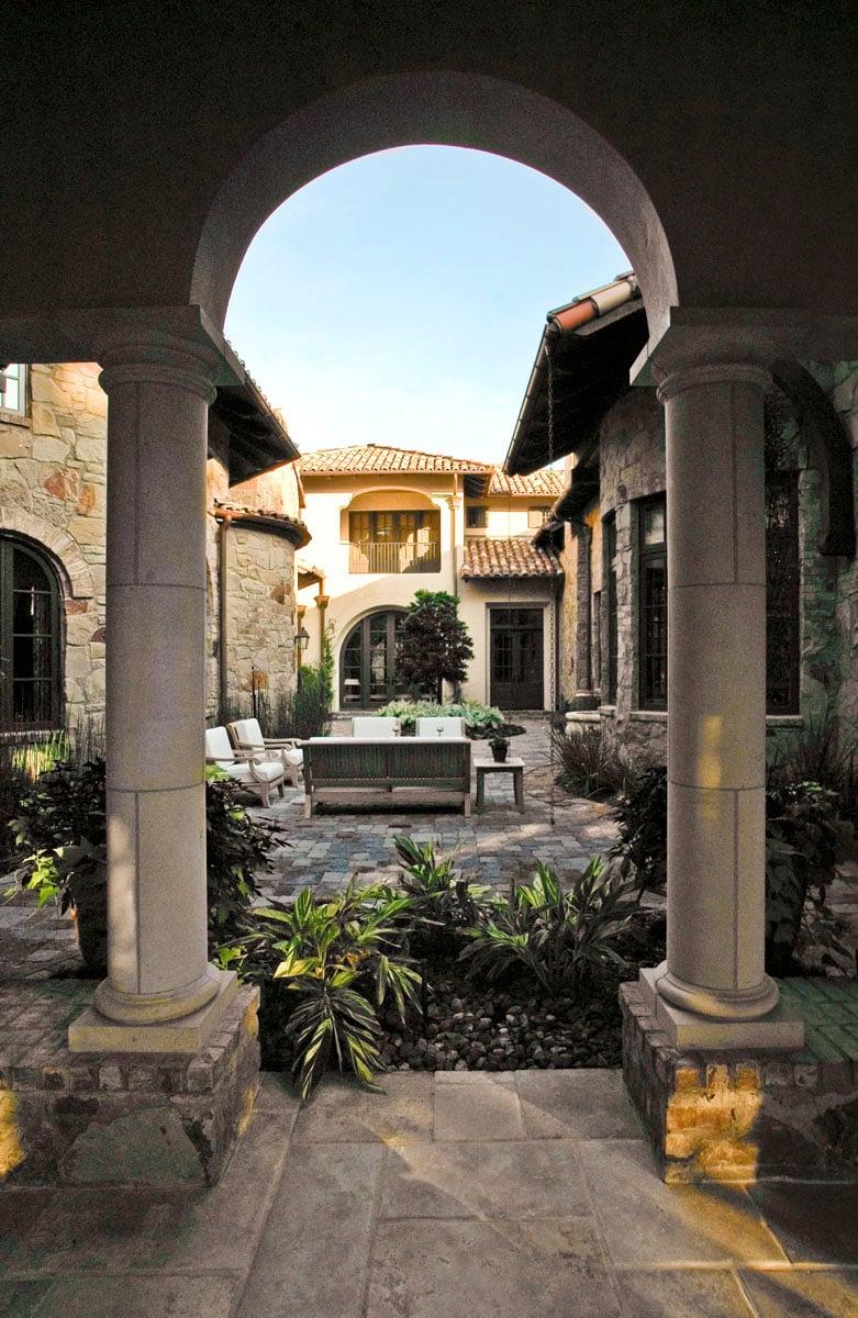 custom tuscan villa backyard archway